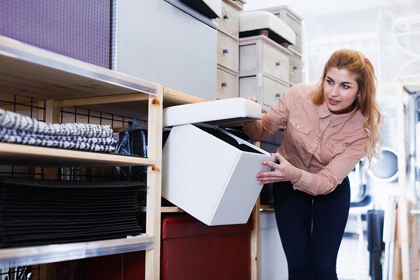 woman opening storage ottoman