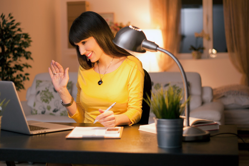 woman at desk with lamp